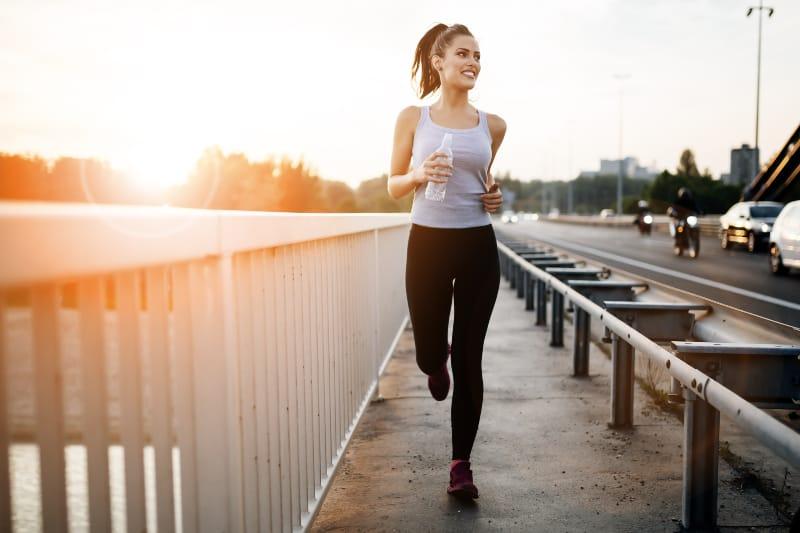 girl running on the bridge