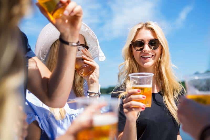 group of female friends drinking beer outside
