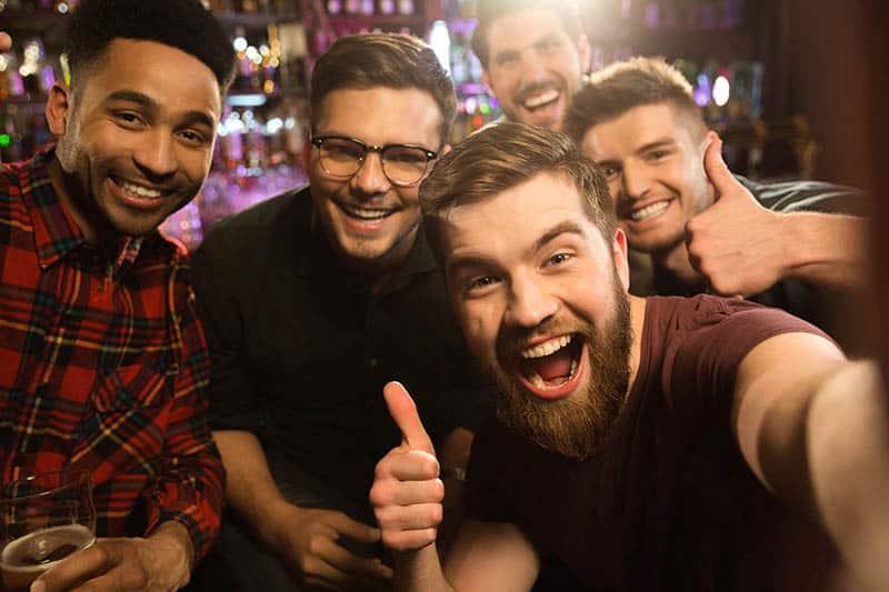 group of male friends taking a selfie