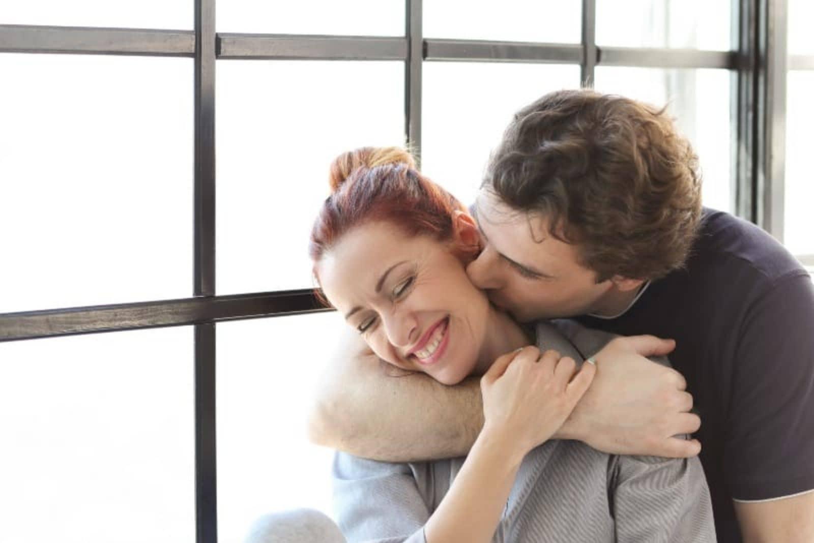 guy kissing his girlfriend in neck