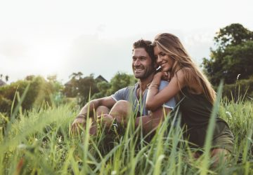 couple enjoy together in grass