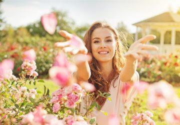 happy girl in flowers