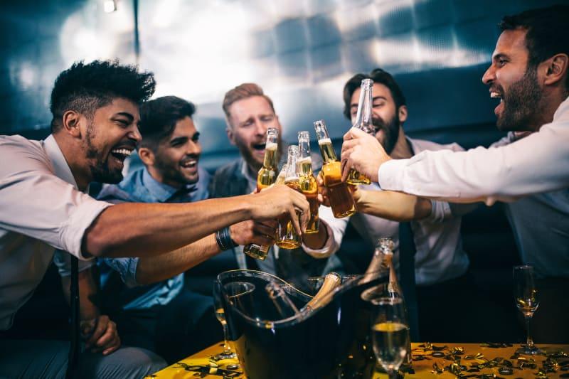 man cheering beer at the club