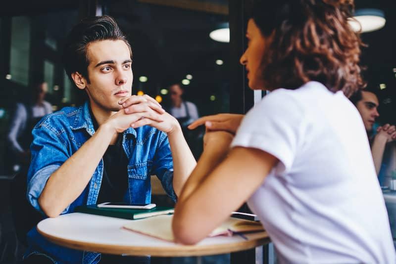 man listening to woman