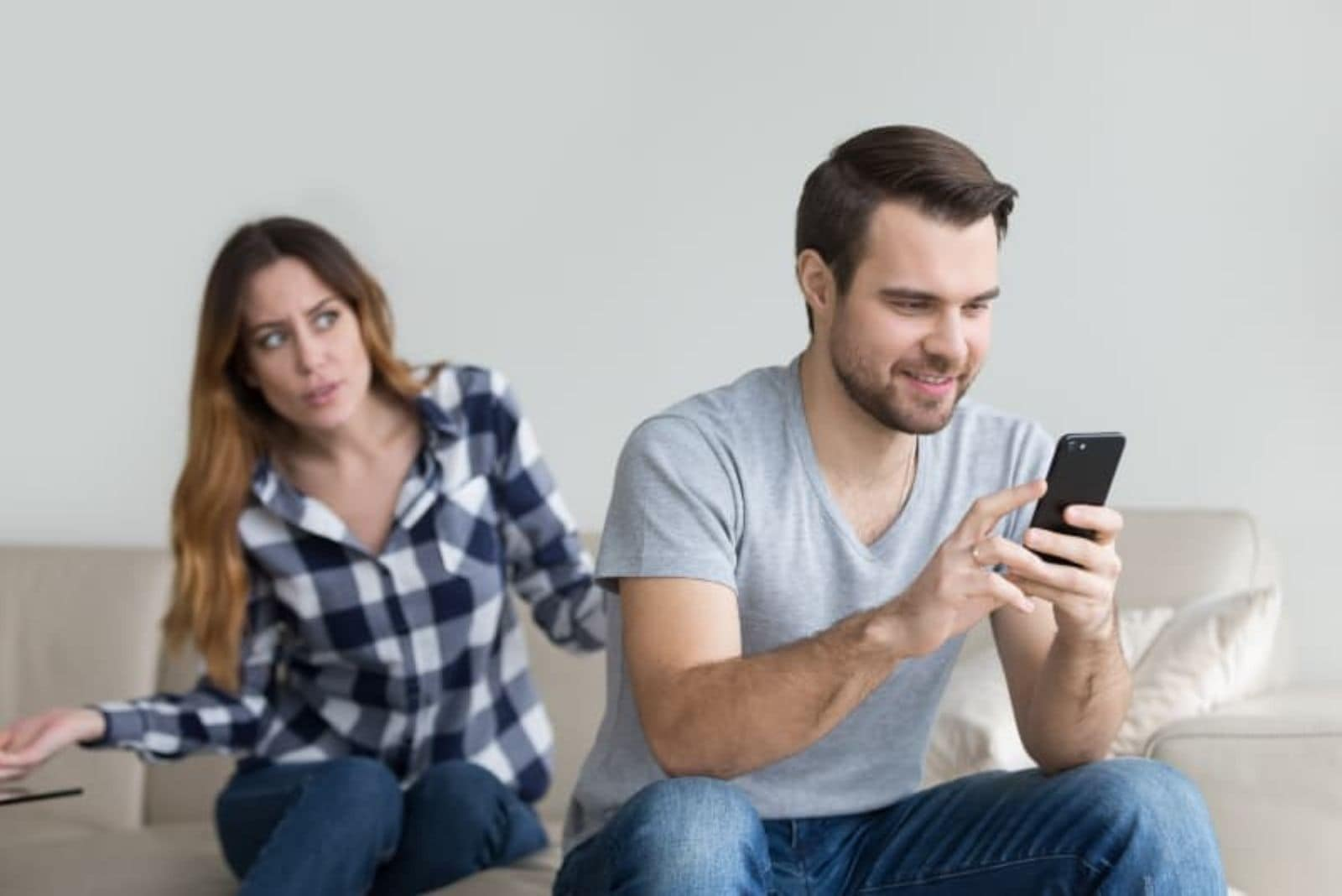 nervous woman while man holding phone