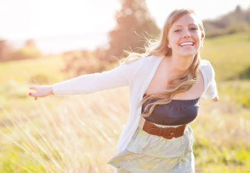 cheerful happy woman in field