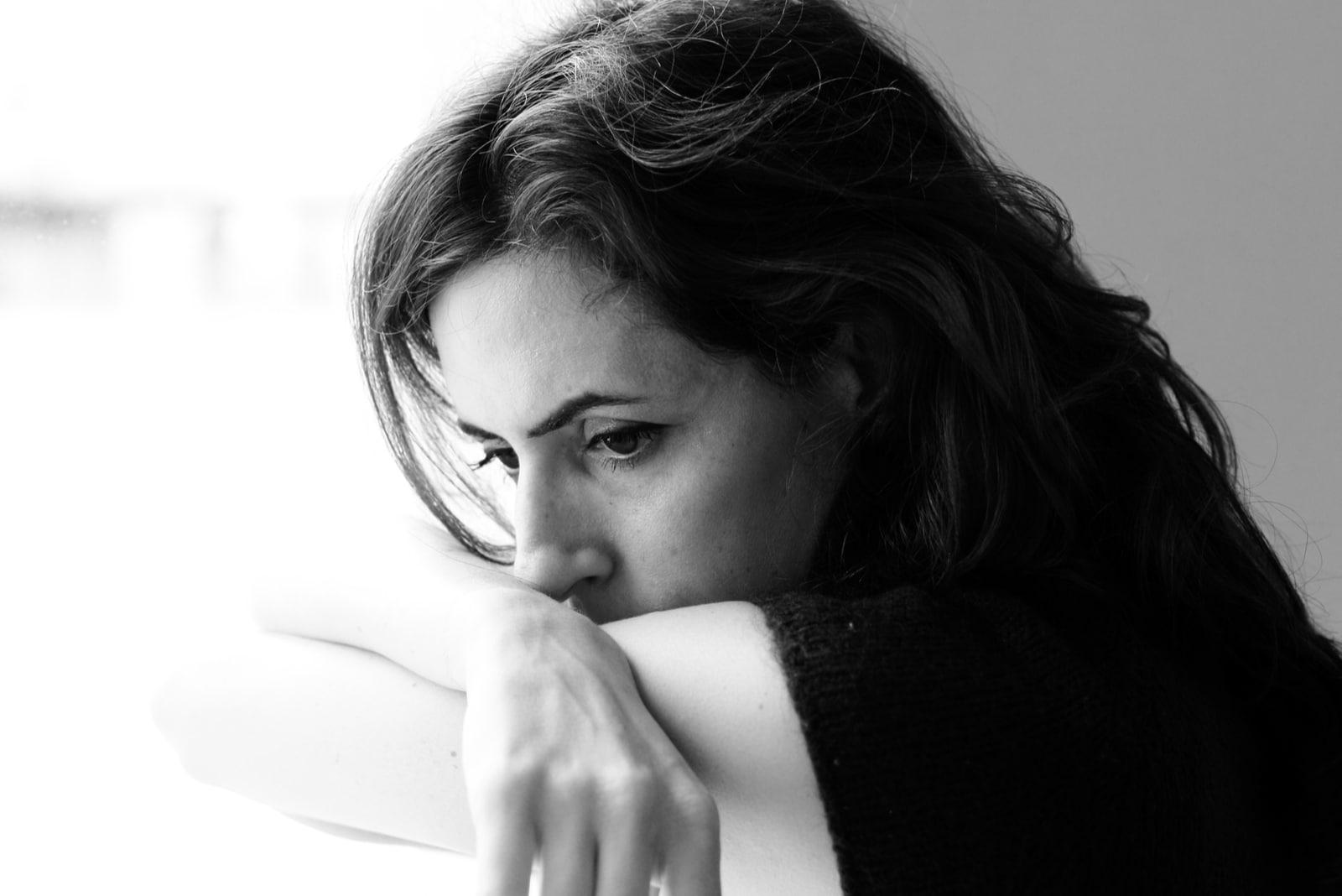 pensive woman sitting alone