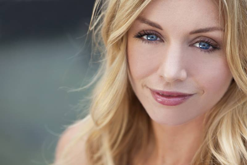 portrait of beautiful woman with blonde hair and blue eyes