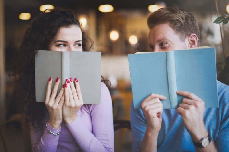shy couple flirting while studying