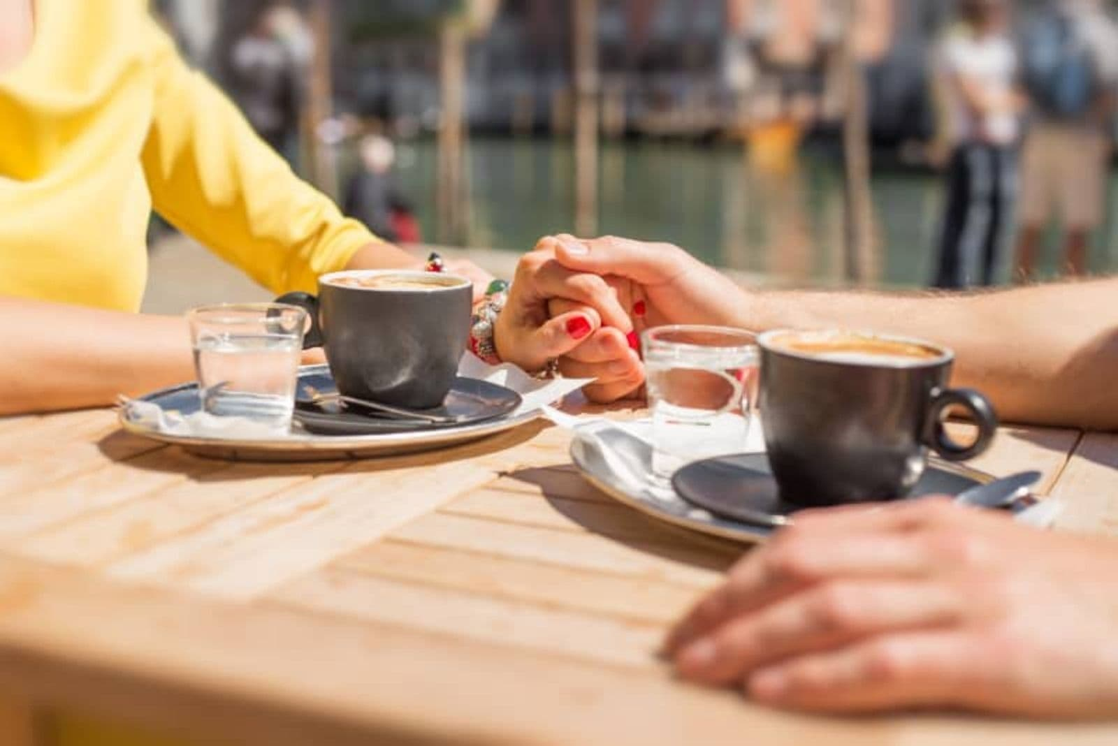 sunkissed couple drinking coffee