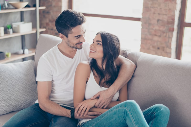 woman looking in man who hugged her