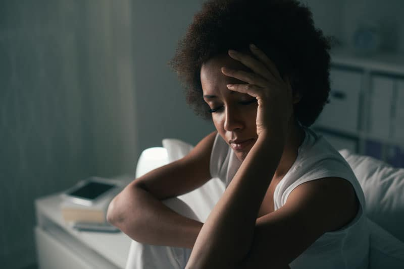 sad woman crying on her bed