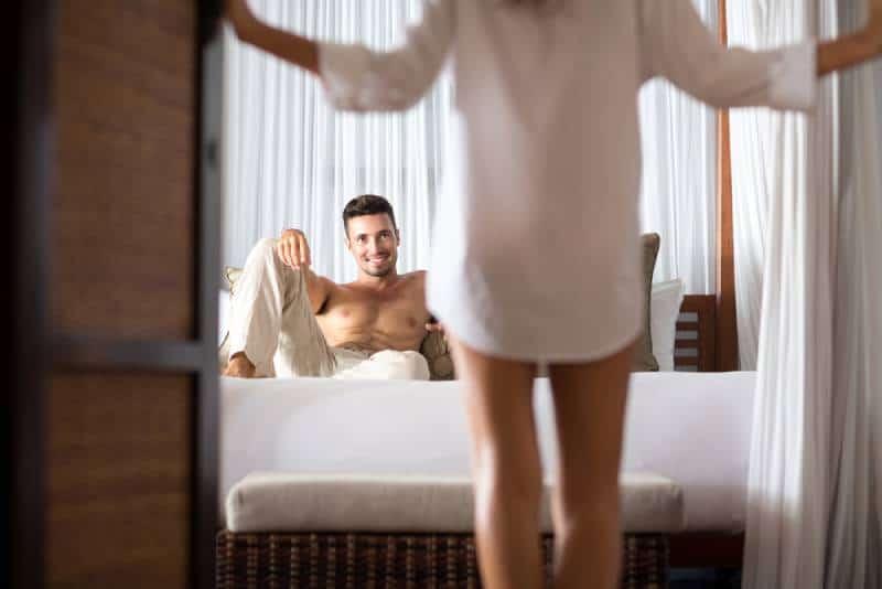 woman seduces her boyfriend in the bedroom