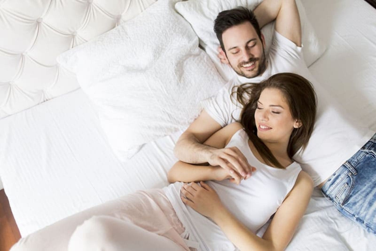 young couple in love laying in bed