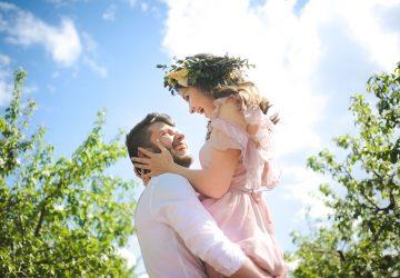 happy man holding his girlfriend