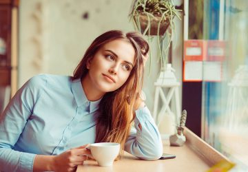 young woman drinkin a coffee