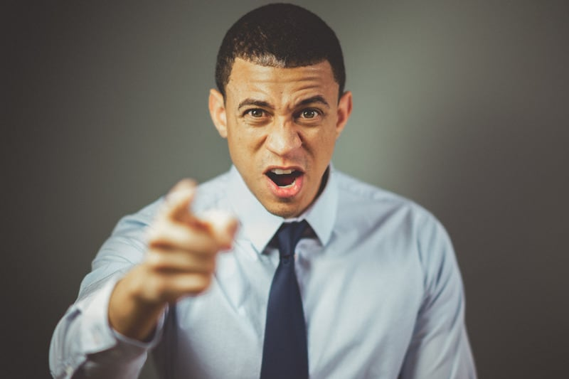 angry man pointing finger on polo and necktie