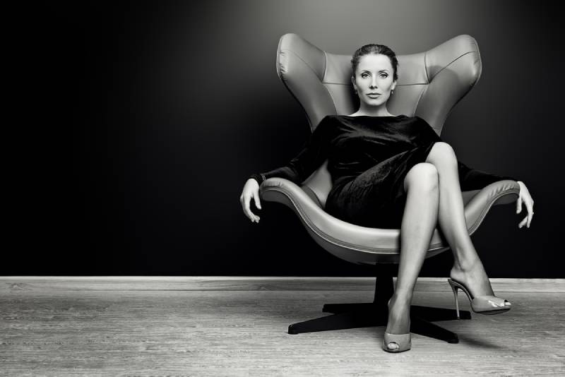 confidence woman sitting on chair