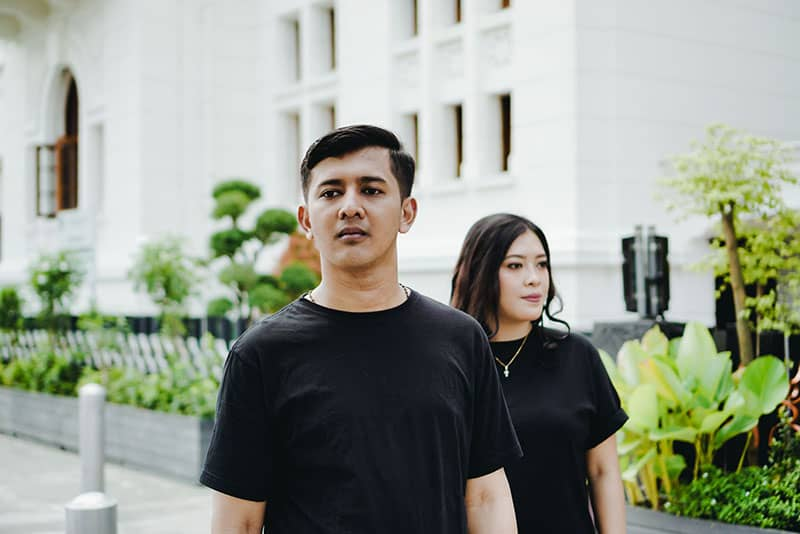 Couple Wearing Black Shirts facing different directions