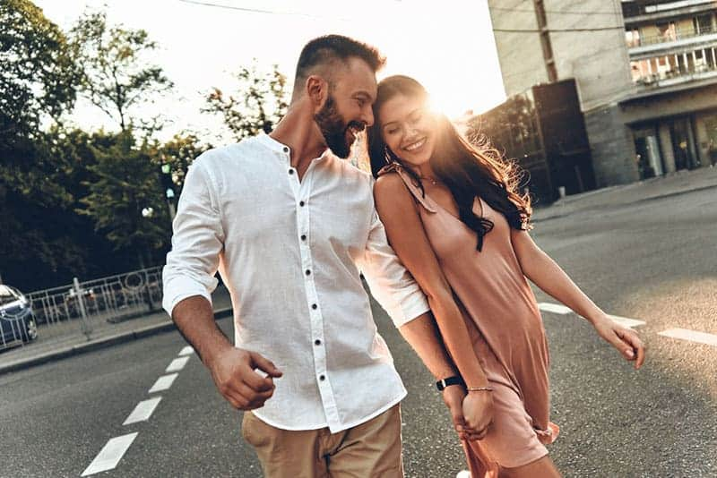 happy man flirting with woman on the street
