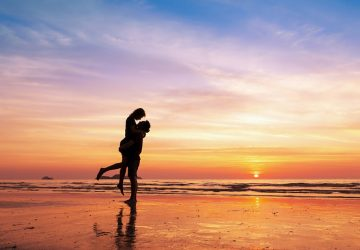 silhouette of a lovely young couple in sunset