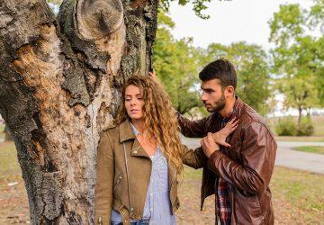 Attractive girl ignoring her boyfriend in the public park