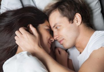 happy couple talking in the bed