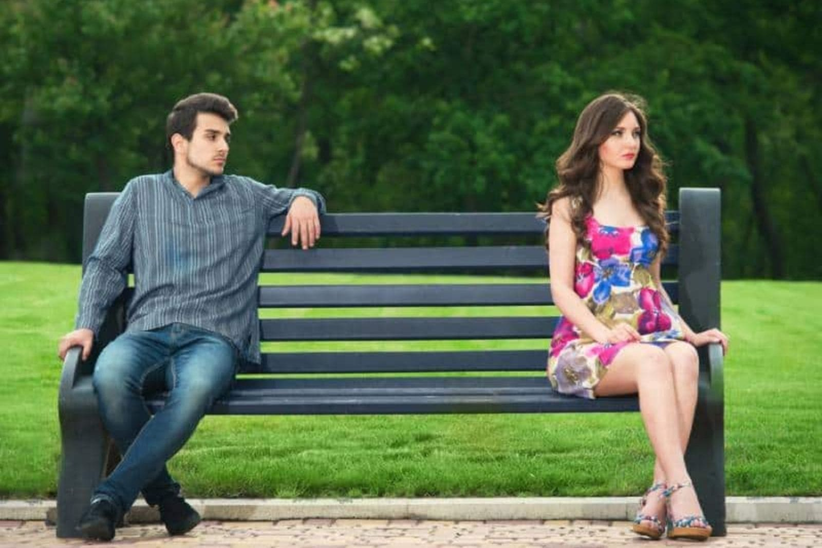a man and a woman sitting on a bench