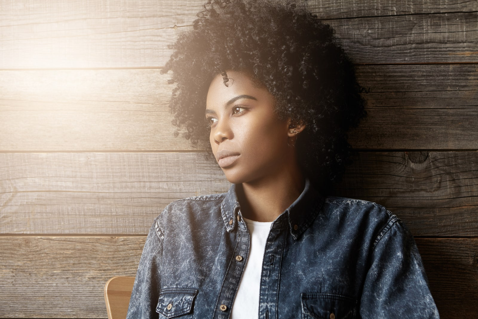 a woman with frizzy hair is sitting