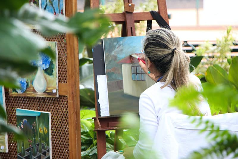 adult woman artist painting on canvass