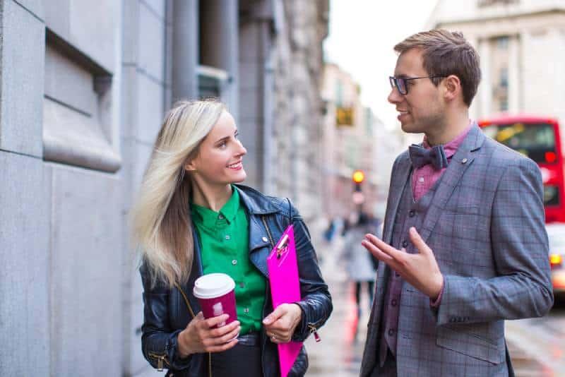 business couple talking outside