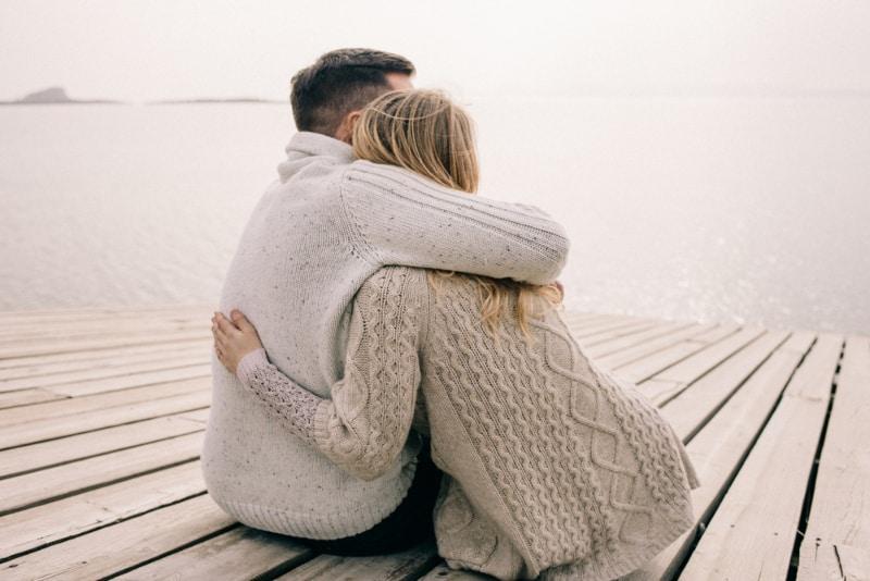 couple hugging and enjoying sea view