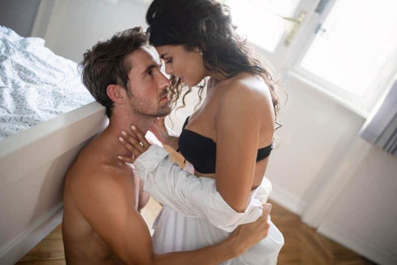 couple in underwear on floor