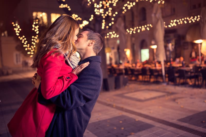 couple kissing in the middle of the town