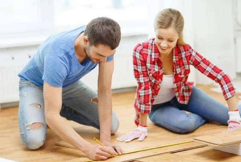 couple making diy project with wood