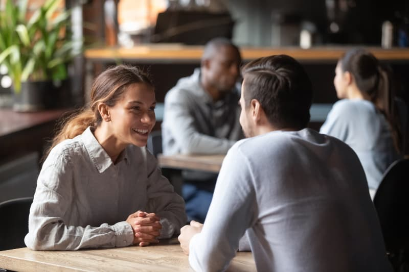 couple sit at cafe table