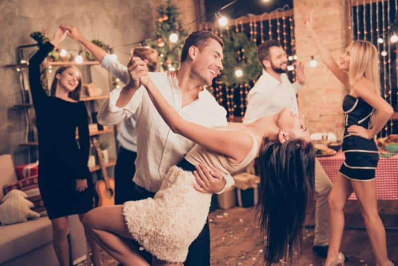 couples having good time and dancing