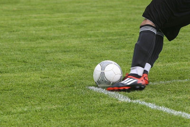 field-grass-sport-foot-kicking a ball