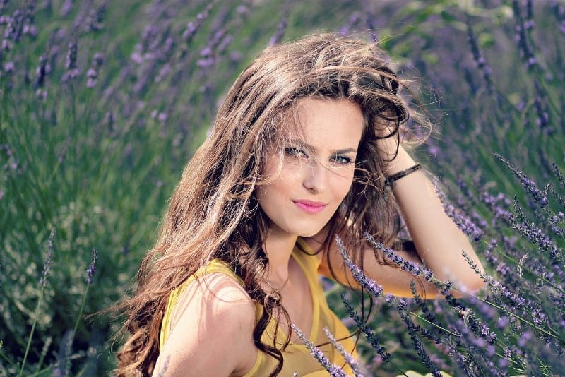 Girl poses in the field of lavander