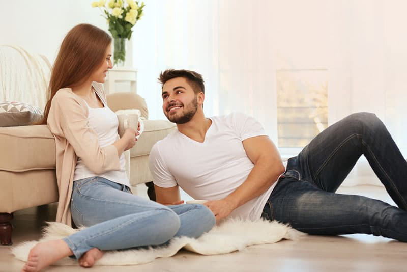 handsome man talking with woman on the floor