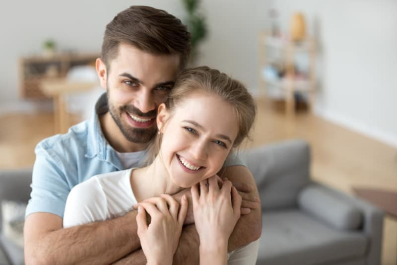 happy couple hugged at home