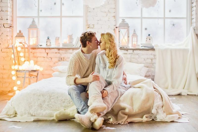 happy couple in white room
