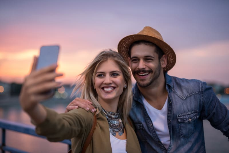 happy couple making selfie
