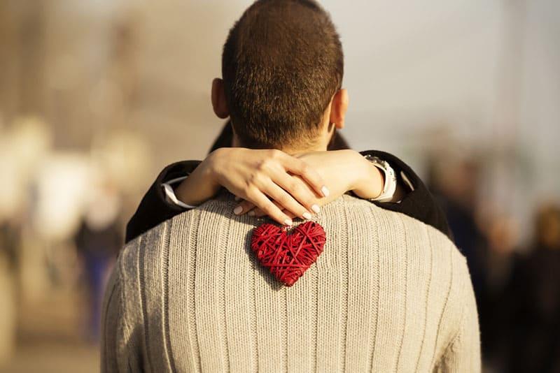 happy woman huging a man