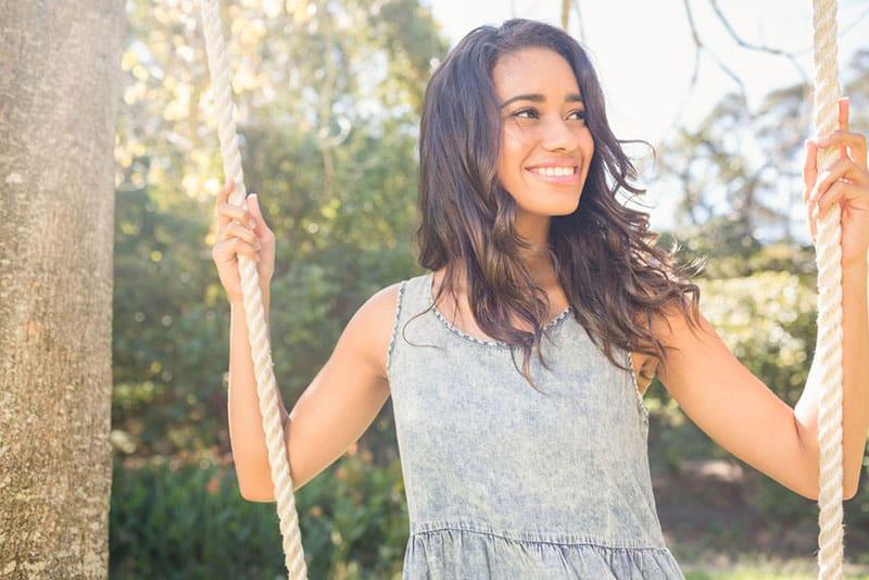 happy woman on the swingset
