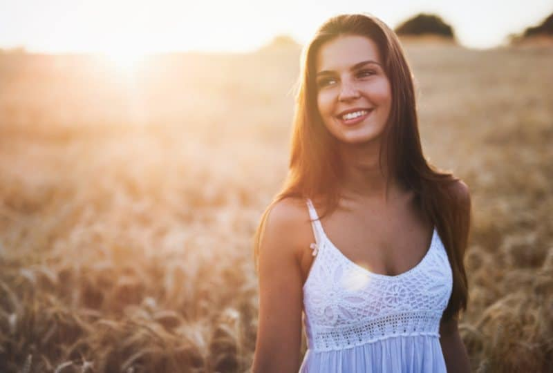 happy young woman in fields outdoors