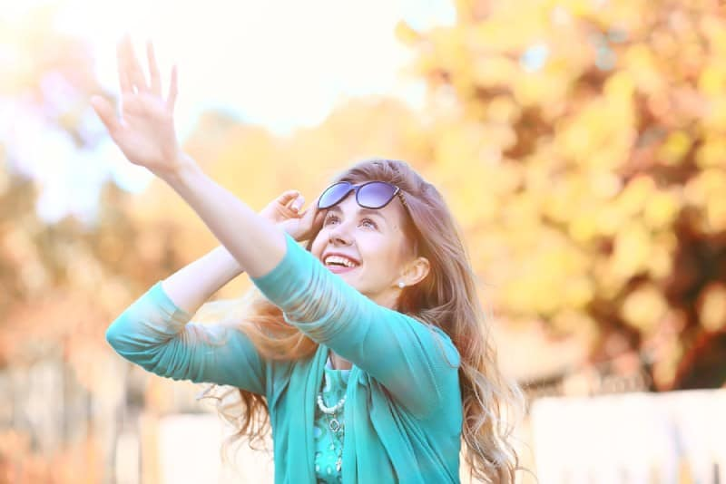 happy young woman outside on autumn