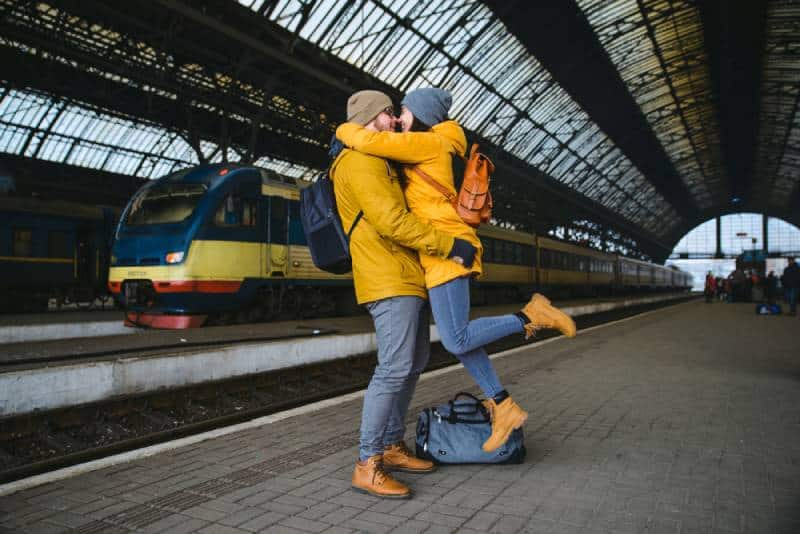 hugging couple meet after long time