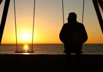 lonely man near sea