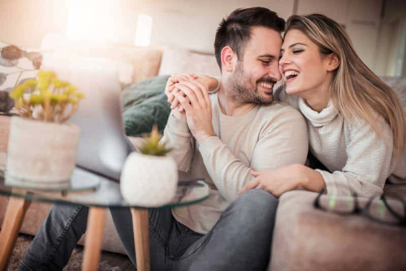 lovely couple smiling in living room